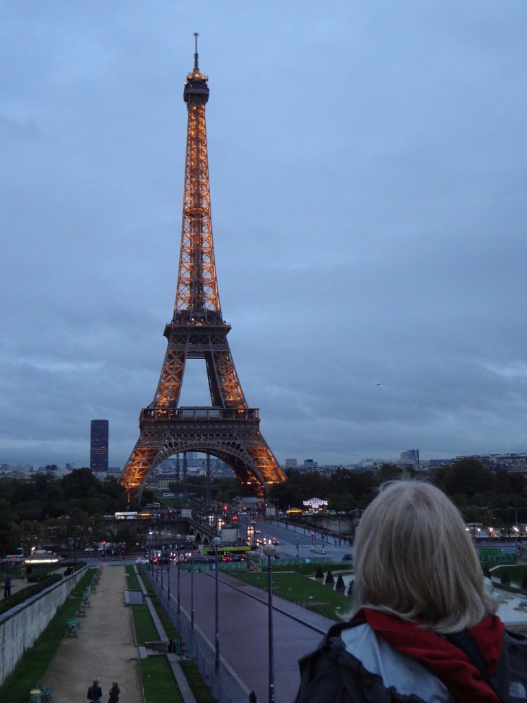Photo of the Eiffel Tower in Paris, at dusk.