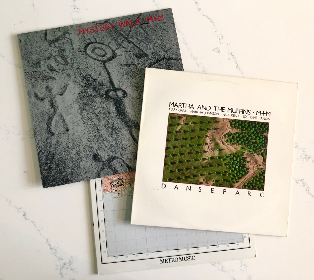 Photo of three long-play record covers.